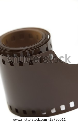 A roll of 35mm film, isolated on white. - stock photo