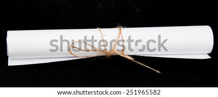 a roll of paper on a black background