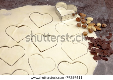 a rolled out dough for biscuits with cookie cutter for cookies - stock photo