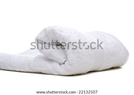 A rolled up white towel on a white background - stock photo