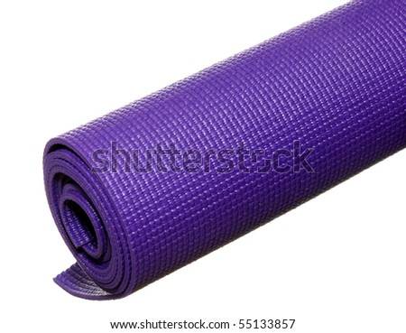 a rolled up yoga or pilates sticky mat isolated on white. - stock photo