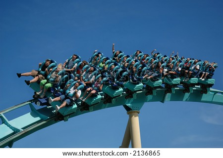 A roller coaster ride at theme park - stock photo