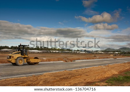 a roller truck preparing the new road - stock photo