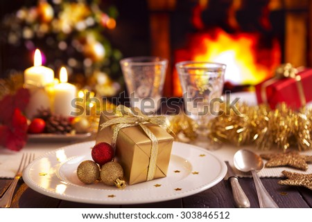 A romantic Christmas dinner table setting with candles and Christmas decorations. A fire is burning & Romantic Christmas Dinner Table Setting Candles Stock Photo (Edit ...