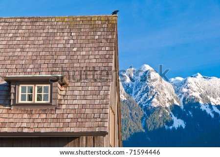 A roof with a view over gorgeous mountains in West Vancouver, British Columbia. - stock photo