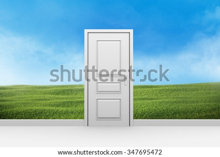 A room with a closed door and a lawn of green grass behind the wall. - stock photo