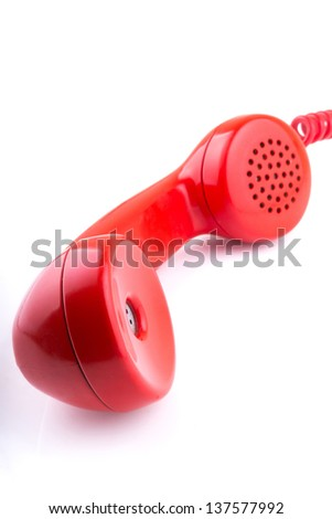 A rotary telephone hand set isolated against a white background - stock photo