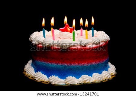 A round frosted cake with candles. - stock photo