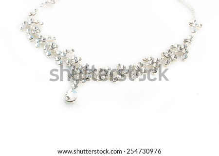 A round silver metal necklace with crystal, isolated on white background, closeup - stock photo