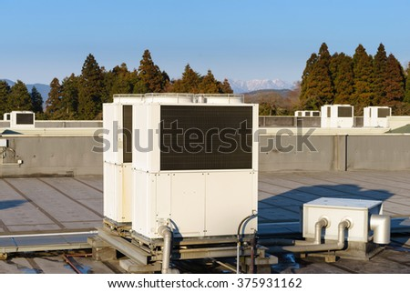 A row of air conditioning units on a rooftop