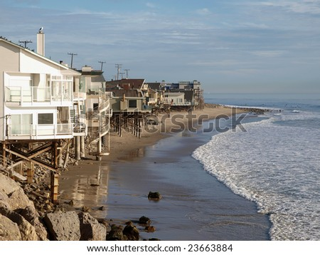 A row of beach front homes enjoying the warm California sun. - stock photo