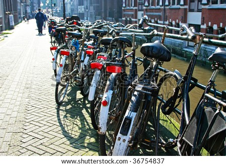 A row of bicycles in Amsterdam, The Netherlands. - stock photo