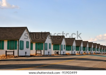 A row of boarded up cottages on Rt. 6A, between Provincetown and Truro, Massachusetts, on a January day - stock photo