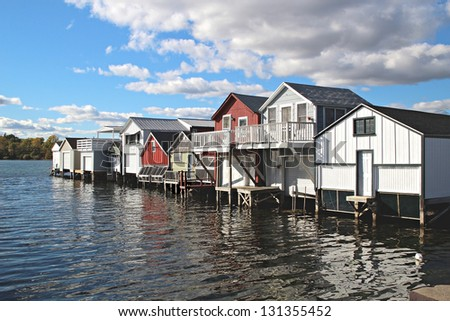 A row of boat houses on Canandaigua Lake in the Finger Lakes region of New York. Boathouses on Canandaigua Lake, New York - stock photo