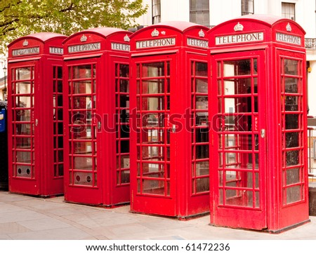 A Row Of  British Red Telephone Boxes. - stock photo