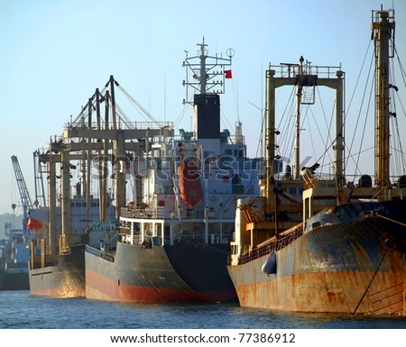 A row of cargo vessels is anchored at Kaohsiung Port - stock photo
