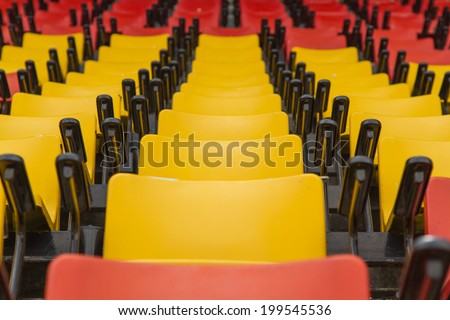 A row of chairs in stadium  - stock photo