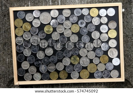 A row of coins on a blackboard.