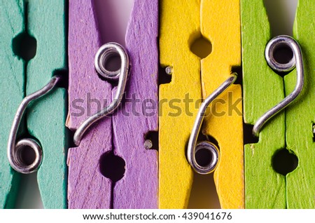 a row of color wooden clothespins - stock photo