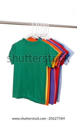 A row of colorful row t-shirts hanging on hangers on a white background, add copy or graphic to front of shirt - stock photo