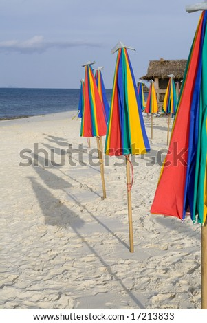 A row of colorful umbrellas on the beach. Copy space - stock photo