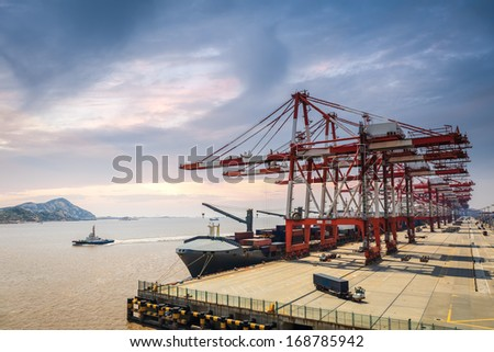 a row of crane in shanghai container deepwater port ,foreign trade and port machinery background  - stock photo