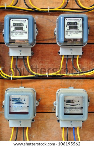 A row of electric meters measuring power use - stock photo