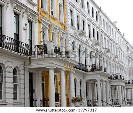 A Row of Expensive White Terrace Houses in London. - stock photo