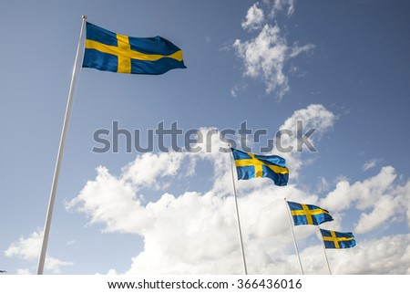 A row of four Swedish flags - stock photo