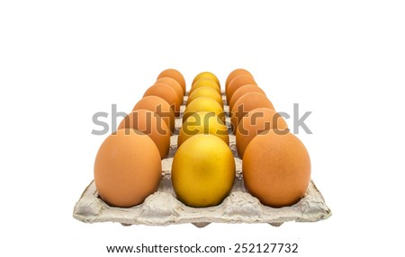 A row of golden eggs on an egg tray: A golden egg opportunity concept of fortune and a chance  - stock photo