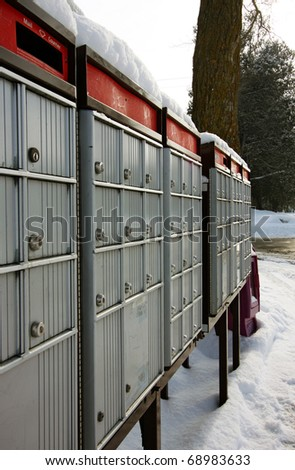 a row of mailboxes - stock photo