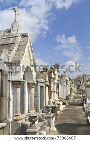 A row of marble and granite tombs above ground tombs in Lafayette Cemetery #2 in New Orleans, Louisiana