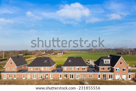 A row of new houses in the Netherlands.Aerial view - stock photo