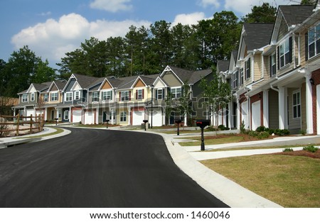 A row of new townhomes or condominiums. - stock photo