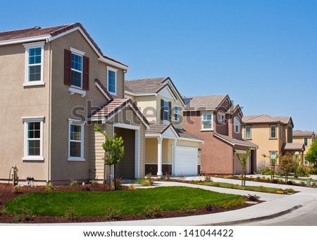 A row of new tract houses in a residential subdivision near San Jose, California. - stock photo