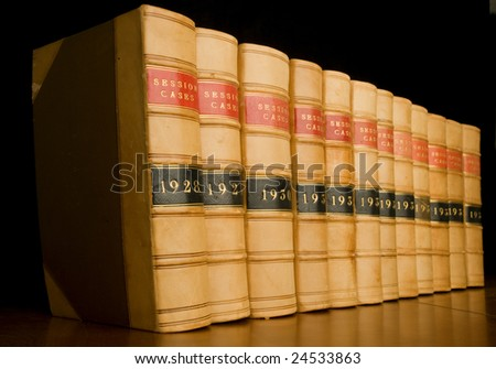 A row of old law reports. - stock photo