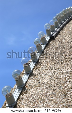 A row of outdoor Lamps with the sky background