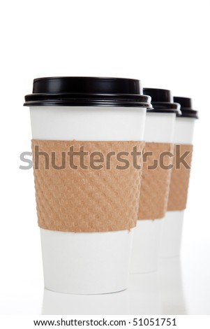 A row of paper coffee cups on a white background - stock photo