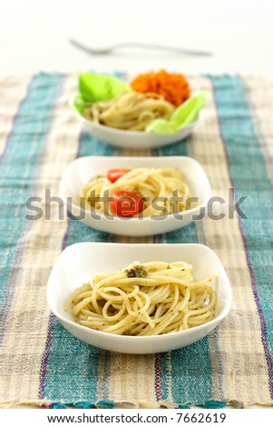 A row of  pasta olio in small square shaped bowls - stock photo