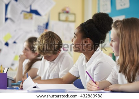 A row of primary school children in class, close up