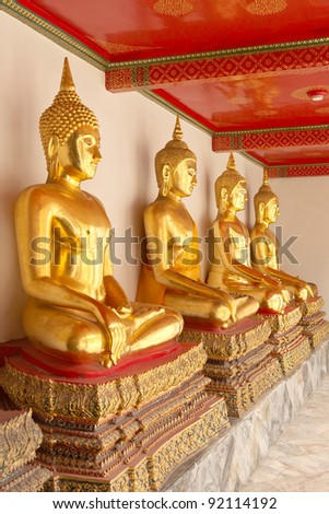 A row of seated Buddhas - stock photo