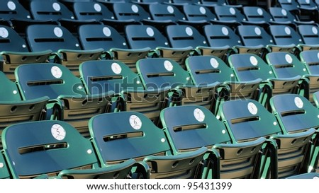 A row of seats in a baseball stadium before the fans arrive - stock photo