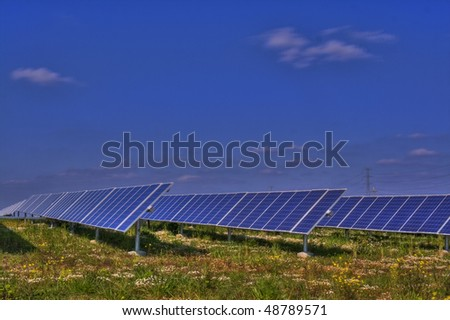 A row of Solar Photovoltaic panels in a colorful country side