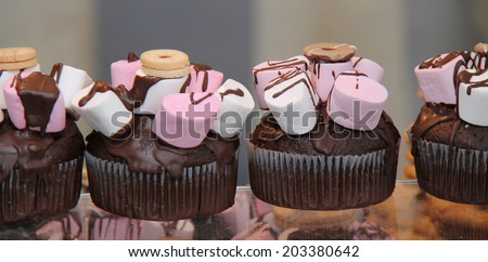 A Row of Sweet Confectionery Dessert Cakes. - stock photo