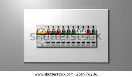 A row of switched off household electrical circuit breakers on a wall panel - stock photo