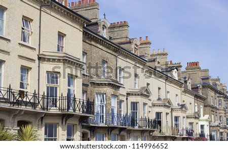 A row of Victorian townhouses on Lowestoft, seafront, these houses are Grade 2 listed Victorian buildings. - stock photo