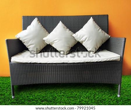 a row of white pillow on sofa - stock photo