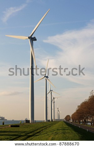 A row of wind mills on a strip of land in the harbour of Rotterdam, Holland