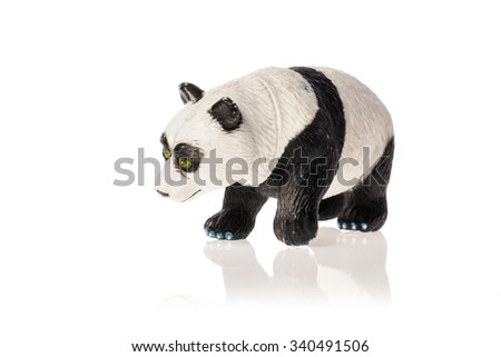 A rubber(plastic) toy of panda bear side view isolated white.