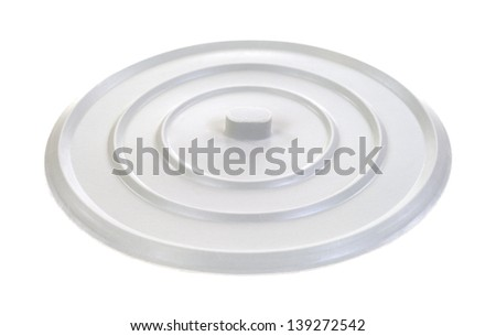 A rubber sink stopper to hold water in a wash basin on a white background.